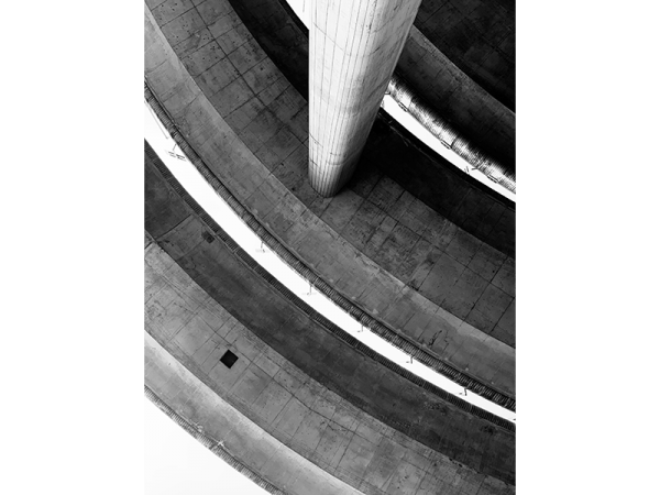 A black and white photograph depicting a part of bridges from a look up angle by Guillaume HOW CHOONG
