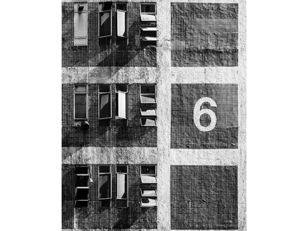A black and white photograph of a Hong Kong public housing in Hong Kong in a close up angle by Guillaume HOW CHOONG