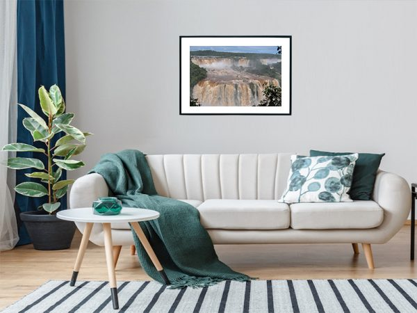 An inspiration of home decoration with a landscape photograph of the great water fall in brasil hanged in the living room