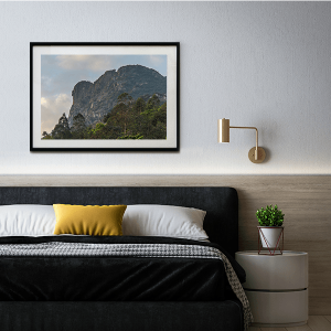 An inspiration of home decoration with a landscape photograph of the Lion Rock in Hong Kong hanged in the bedroom