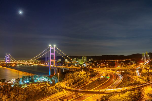 A photograph of a night scene at the highway near Ting Kau bridge in Hong Kong by Kilias Hung
