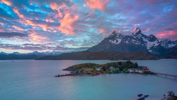 A photograph of a sunset scene with mountains and coast in Chile by Kilias Hung
